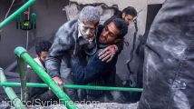 Helped to freedom from the rubble after the Syrian government strike Douma only days ago