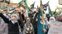 Women standing in solidarity with Syrian detainees and martyrs